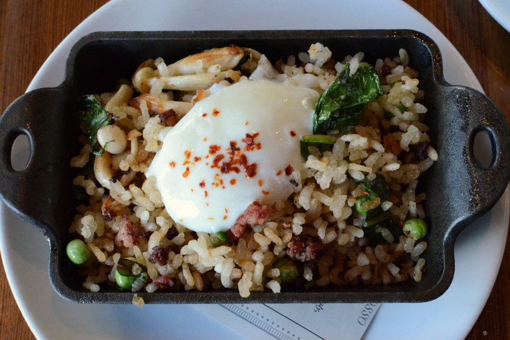 Delicious and unique Farm Egg with fried Carolina gold rice that tastes almost like Rice Krispies, mixed with beet greens, beech mushrooms and chicken sausage.